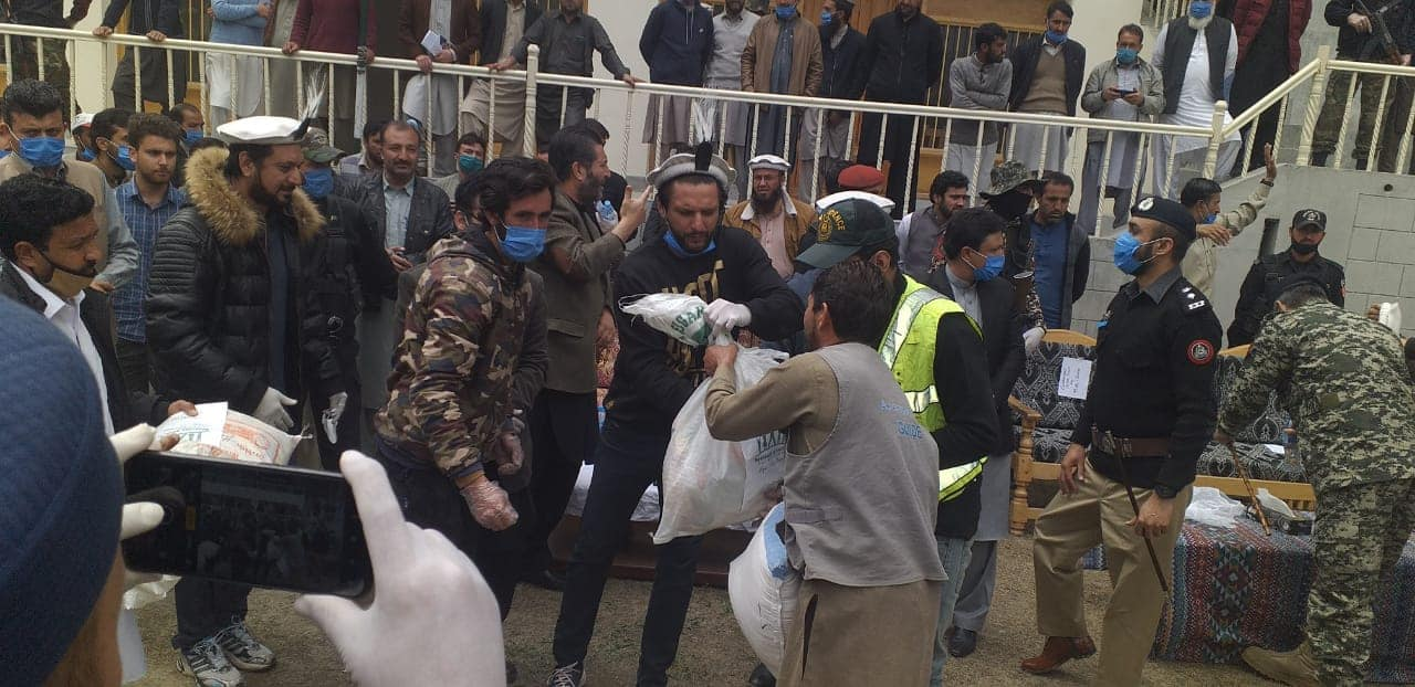 Afridi distributing flour in Chitral